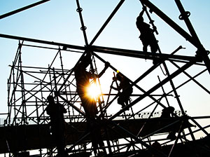 Construction workers on the frame of a building